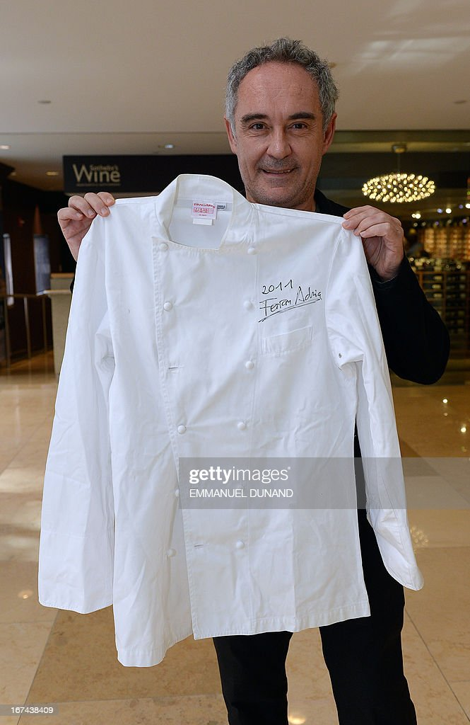 Spanish star chef Ferran Adria, of the award-winning restaurant elBulli, poses with an authographed chef jacket which will go for auction with the entire wine cellar, in New York, April 25, 2013. Adria decided to permanently close his restaurant and put the entire content of elBulli's wine cellar for auction, which is scheduled for April 26, 2013 at Sotheby's. The proceeds will be used to sponsor his elBulli Foundation, aimed at preserving and celebrating the restaurant's accomplishments, while keeping it as a center for gastronomic innovation. This new endeavour would allow him and his team the freedom to continue nurturing the creative drive that had defined elBulli, but without the restrictive timetable and demands of a restaurant. AFP PHOTO/Emmanuel Dunand