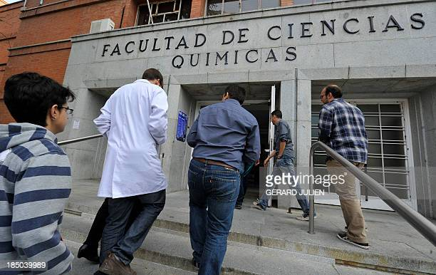 Spanish students and teachers some of them wearing white coats take part in the Dia de luto por la Ciencia to protest against government's spending...
