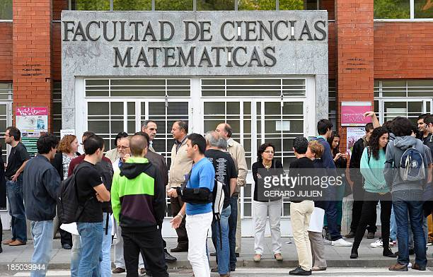 Spanish students and teachers stand in front of the Department of Mathematical Sciences at the Complutense University of Madrid on October 17 during...