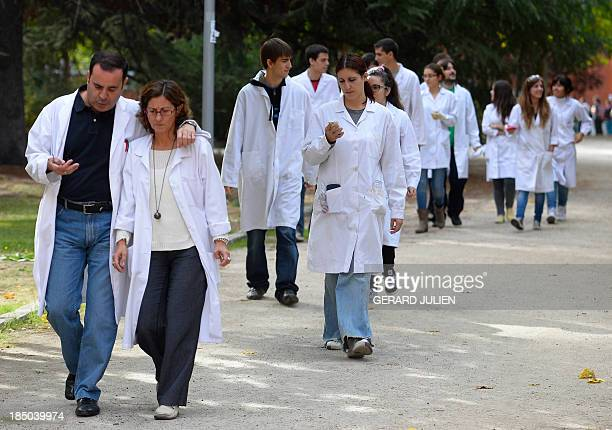 Spanish students and teachers wearing white coats take part in the Dia de luto por la Ciencia to protest against government's spending cuts in...