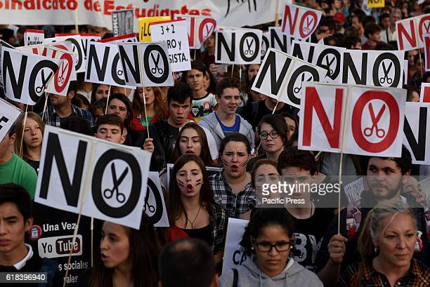 Spanish students shout slogans in Madrid during a protest against the education reform LOMCE and the cuts in the public education system An estimated...