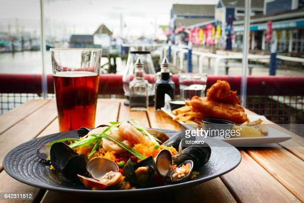 spanish style seafood paella at steveston fisherman's wharf in richmond bc canada - richmond british columbia stock photos and pictures