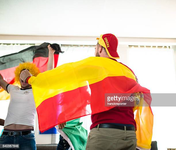 spanish supporter at home looking the tv