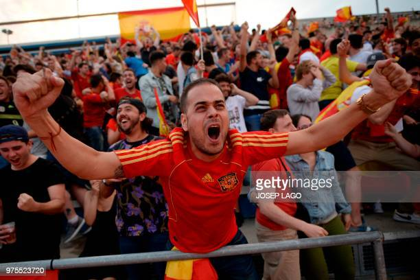 A Spanish supporter celebrates his team´s third goal while watching the Russia 2018 World Cup Group B football match between Portugal and Spain on...