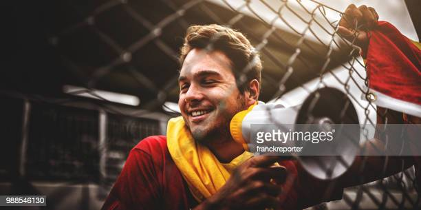 spanish supporter with the megaphone - fan enthusiast stock pictures, royalty-free photos & images