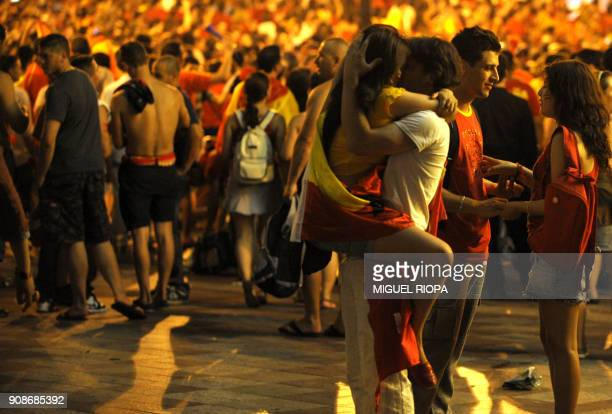 Spanish supporters celebrate after the World Cup final football match Spain against Netherlands on July 11 2010 in Madrid Spain won the World Cup for...