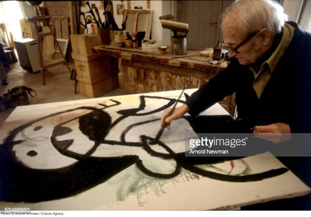 Spanish Surrealist artist Joan Miro paints in his studio March 22 1979 in Mallorca Spain