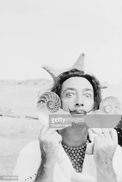 Spanish surrealist artist Salvador Dali holds up two seashells at his home in Cadaques on the Costa Brava Spain 8th January 1955 Original Publication...