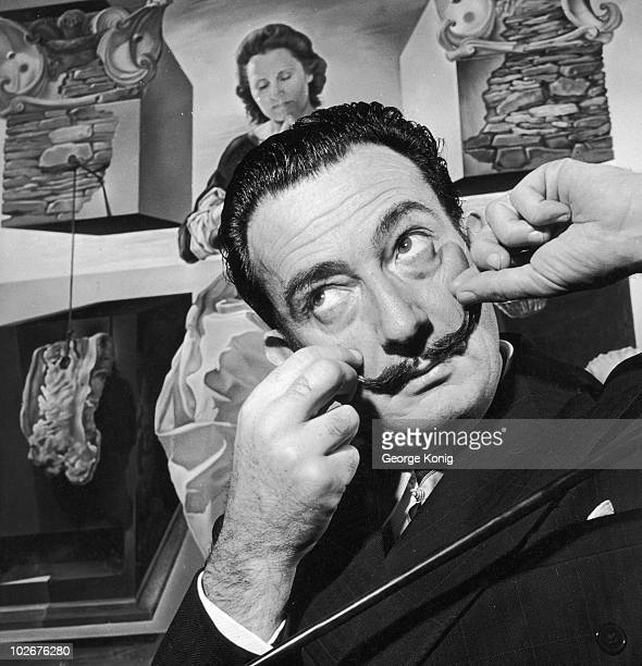 Spanish surrealist artist Salvador Dali in London with one of his paintings entitled 'The Madonna of Port Lligat' December 1951