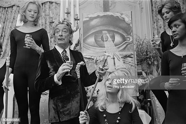 Spanish surrealist artist Salvador Dali surrounded by young women in his hotel suite during a visit to London UK 28th January 1971