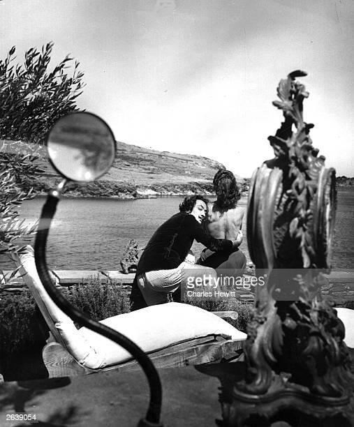 Spanish surrealist artist Salvador Dali with his wife Gala at the garden of his home in Cadaques on the Spanish Costa Brava Original Publication...