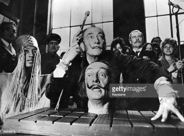 Spanish surrealist painter Salvador Dali with a model of his own head at a press conference in Paris Original Publication People Disc HD0034