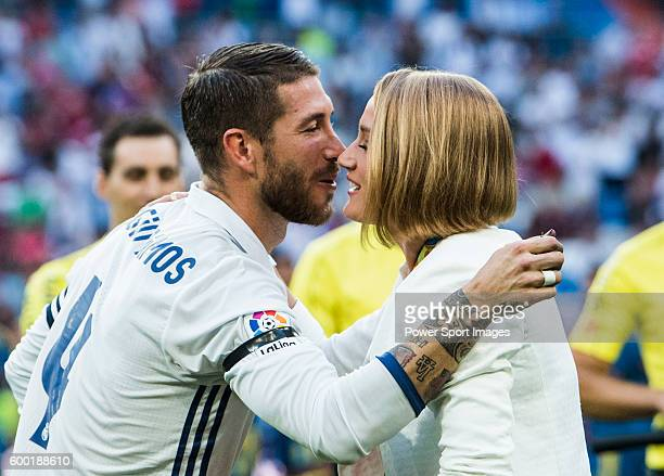 Spanish swimmer Mireia Belmonte Garcia is greeted by Real Madrid's player Sergio Ramos before the La Liga match between Real Madrid vs RC Celta de...