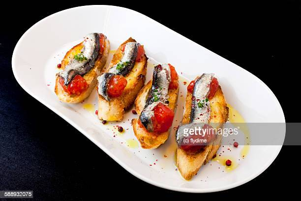 Spanish tapas anchovies with tomato