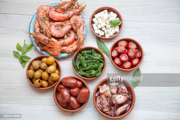 spanish tapas - olive pimento stock photos and pictures