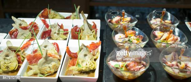 Spanish tapas pintxos artichokes red pepper seafood in tapas bar restaurant Logrono Basque Country Spain