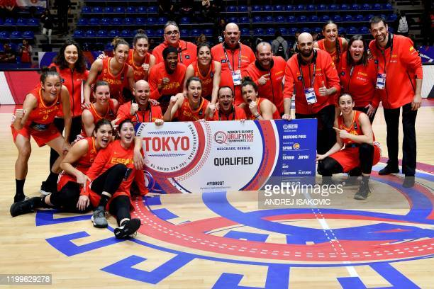 Spanish team players and staff members celebrate at the end of the FIBA Womens Olympic qualifying basketball tournament match between Britain and...