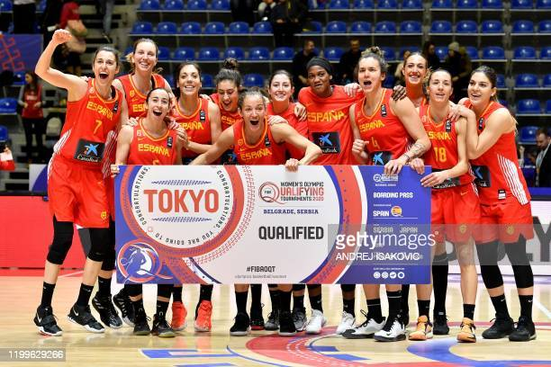Spanish team players celebrate at the end of the FIBA Womens Olympic qualifying basketball tournament match between Britain and Spain in Belgrade on...