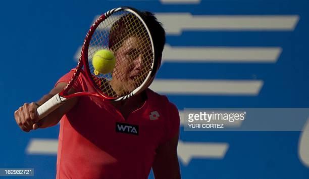 Spanish tennis player Carla Suarez hits a return to compatriot Silvia Soler during their WTA Mexican Open semi-final match, in Acapulco, Guerrero...