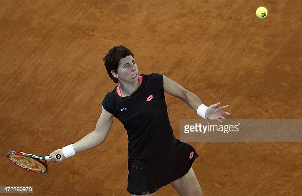 Spanish tennis player Carla Suarez Navarro returns a ball to German player Julia Goerges during day four of the Madrid Open tournament at the Caja...