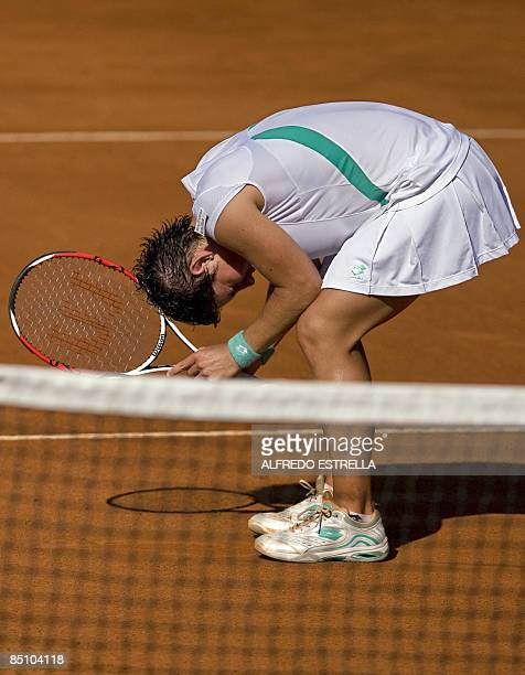 Spanish tennis player Carla Suarez reacts after losing in her WTA Open tennis match against Czech tennis player Barbora Zahlavova, in Acapulco,...