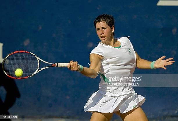 Spanish tennis player Carla Suarez returns the ball to Czech tennis player Barbora Zahlavova during their WTA Open tennis match, in Acapulco, Mexico,...