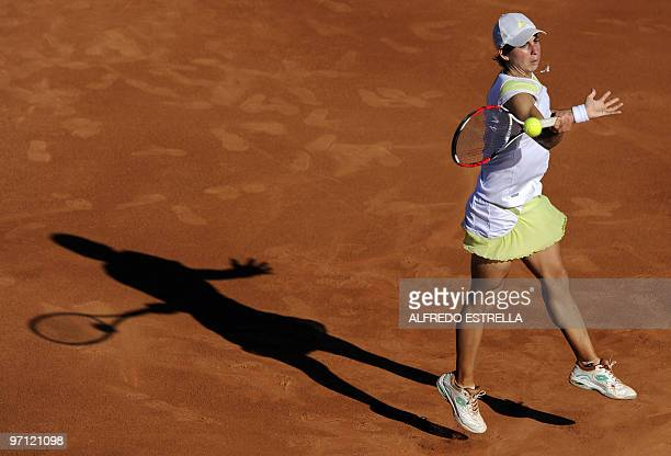 Spanish tennis player Carla Suarez returns the ball to Slovenian tennis player Polona Hercog, during the fifth day of the WTA Open in Acapulco,...