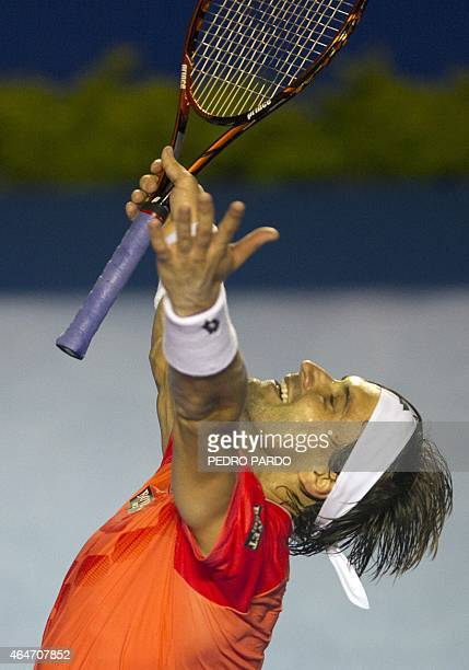 Spanish tennis player David Ferrer celebrates his 46 60 60 win over US tennis player Ryan Harrison during their Mexico ATP Open men's singles...