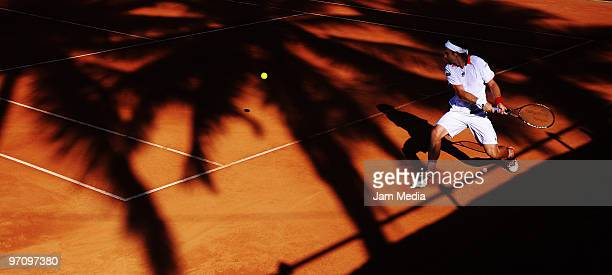 Spanish tennis player David Ferrer returns the ball to Uruguayan Pablo Cuevas during the fourth day of the WTA Open at Princess Hotel on February 25,...