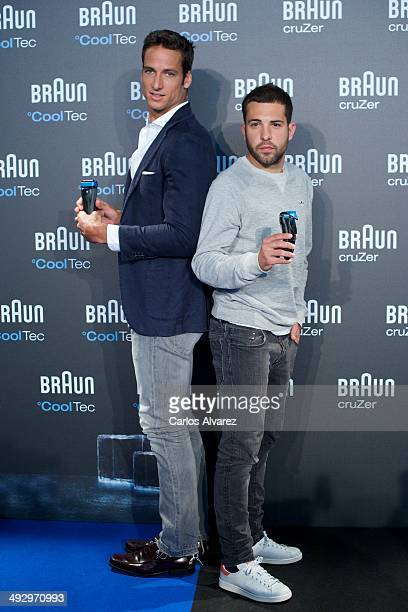 Spanish tennis player Feliciano Lopez and Spanish FC Barcelona player Jordi Alba present the new Braun CoolTec and Braun CruZer on May 22 2014 in...