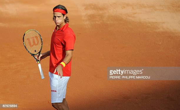 Spanish tennis player Feliciano Lopez gestures as he compete with Fernando Verdasco against US Mike Bryan and Mardy Fish during their double match of...
