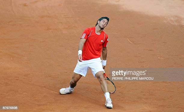Spanish tennis player Fernando Verdasco gestures as he competes with Feliciano Lopez against US Mike Bryan and Mardy Fish during their double match...