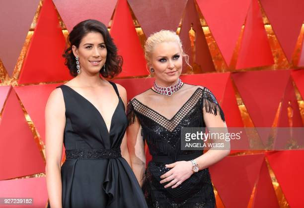 Spanish tennis player Garbine Muguruza and US skier Lindsey Vonn arrive for the 90th Annual Academy Awards on March 4 in Hollywood California / AFP...