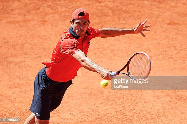 Spanish tennis player Guillermo Garcia-Lopez returns a ball to South African tennis player Kevin Anderson during their Millennium Estoril Open ATP...