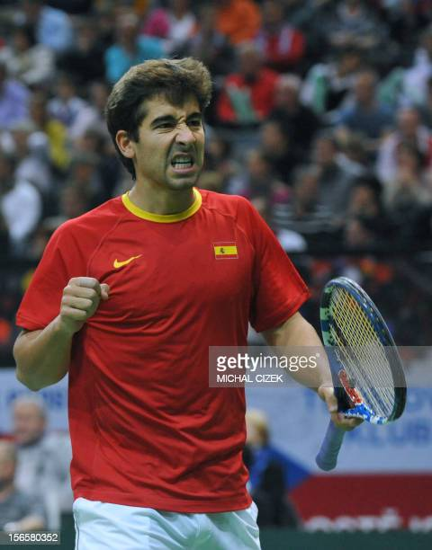 Spanish tennis player Marc Lopez playing with Marcel Granollers reacts during their doubles match against Czech Republic's player Tomas Berdych and...