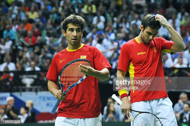 Spanish tennis player Marcel Granollers and Marc Lopez react during their doubles match against Czech Republic's player Tomas Berdych and Radek...