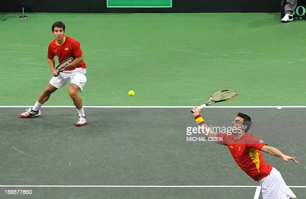 Spanish tennis player Marcel Granollers playing with Marc Lopez returns the ball to Czech Republic's players Radek Stepanek and Tomas Berdych during...