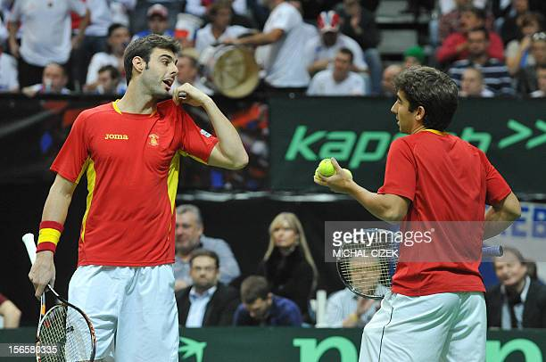 Spanish tennis player Marcel Granollers talks with his teammate Marc Lopez during their doubles match against Czech Republic's player Tomas Berdych...