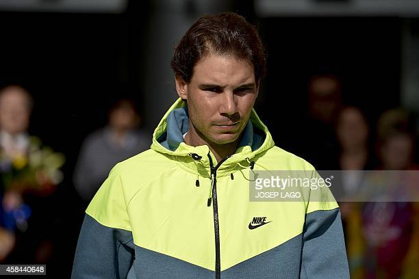 Spanish tennis player Rafa Nadal leaves the hospital in Barcelona on November 5 2014 where he underwent an appendectomy 'Everything went well it was...