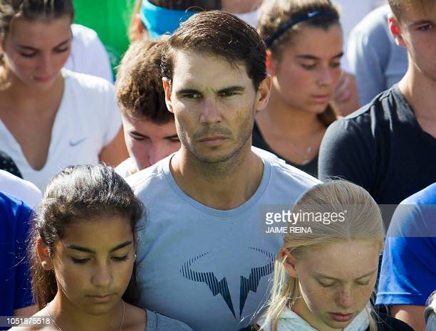 """Spanish tennis player Rafa Nadal observes a minute of silence on October 11, 2018 with students and workers of the """"Rafa Nadal Academy"""" in Manacor to..."""