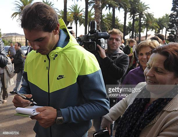 Spanish tennis player Rafa Nadal signs an autograph in Barcelona on November 5 2014 after his release from hospital where he underwent an...