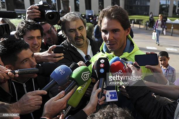 Spanish tennis player Rafa Nadal speaks to the press in Barcelona on November 5 2014 after his release from hospital where he underwent an...