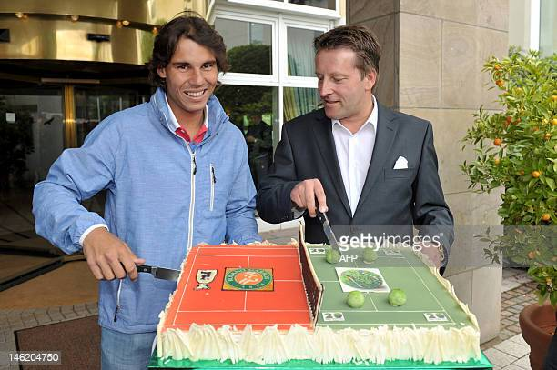 Spanish tennis player Rafael Nadal and Gerry Weber tournament director Ralf Weber cut a cake upon Nadal's arrival at the Hotel near the Gerry Weber...