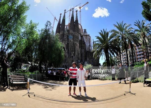 Spanish tennis player Rafael Nadal and Japan's Kei Nishikori pose in front of the Sagrada Familia on April 24, 2012 in Barcelona to promote the Godo...