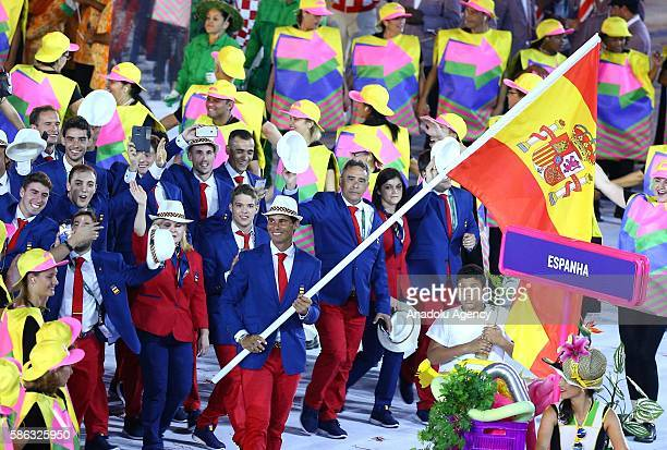 Spanish tennis Player Rafael Nadal carries Spanish Flag as he takes part in the parade during the Opening Ceremony of the Rio 2016 Olympic Games at...