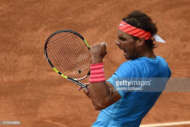 Spanish tennis player Rafael Nadal celebrates a poin in front of US tennis player Steve Johnson during the Madrid Open tournament at the Caja Magica...