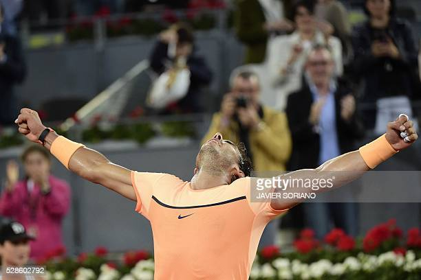 Spanish tennis player Rafael Nadal celebrates after wining his match against Portuguese tennis player Joao Sousa during the Madrid Open tournament at...