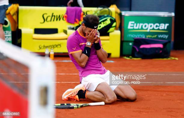 Spanish tennis player Rafael Nadal celebrates his victory over Austrian tennis player Dominic Thiem at the end of their ATP Madrid Open final match...