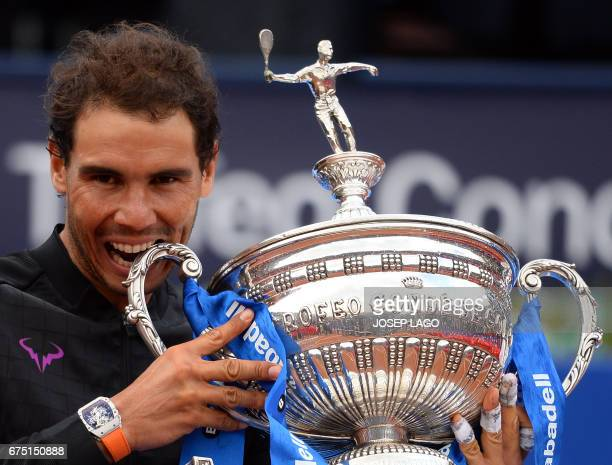 TOPSHOT Spanish tennis player Rafael Nadal celebrates with his trophy after winning Austrian tennis player Dominic Thiem at the end of the ATP...