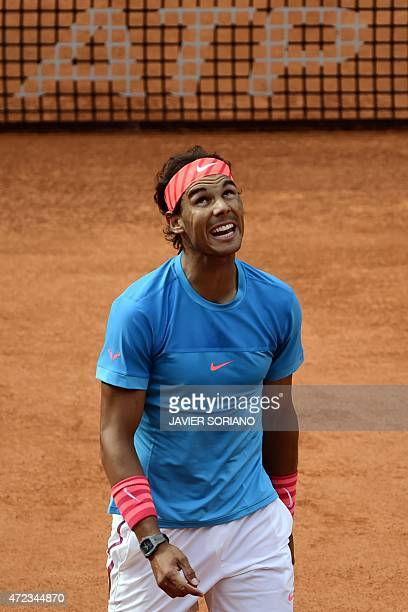 Spanish tennis player Rafael Nadal gestures in front of US tennis player Steve Johnson during the Madrid Open tournament at the Caja Magica sports...